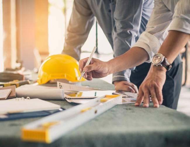 Hands of custom home designer